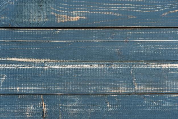 ひびの入ったペンキと暗い、黒、ぼろぼろの木の板から木の板張りの背景
