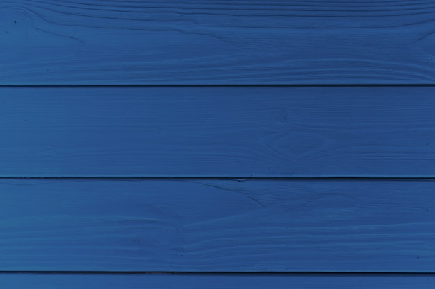 Wooden planks background of classic blue color