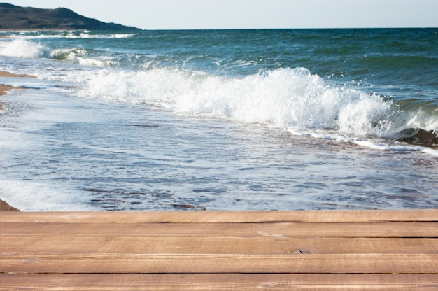 Wooden planks on the background of the sea beach,