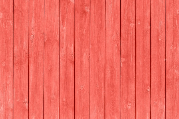Wooden planks painted trendy coral color of the year 2019, background, texture