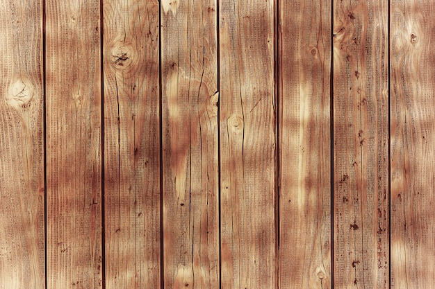 Wooden planks with brown paint
