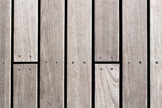 Wooden planks with screws background photo texture