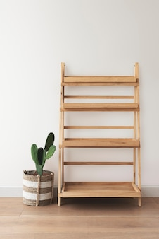Wooden plant stand with a cactus on the side