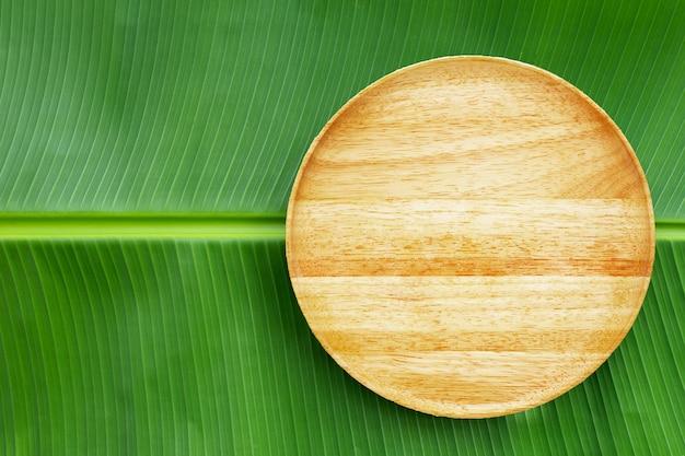 Wooden plate on banana leaf