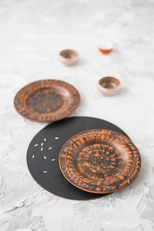 Wooden plate on concrete textured background