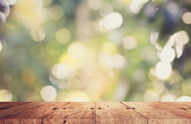Wooden plate with green bokeh background.