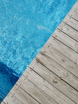 Wooden platform on swimming pool . top view.