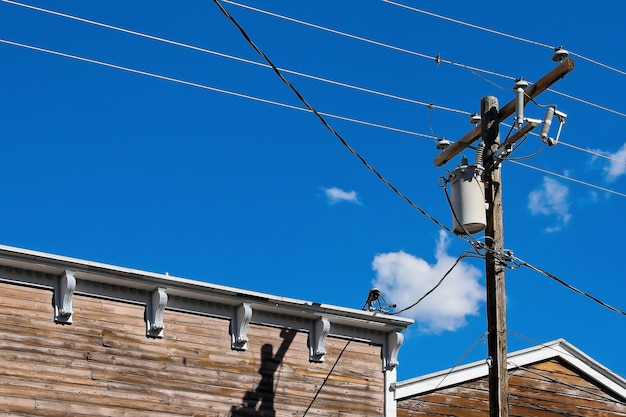 Wooden pole with electric cables