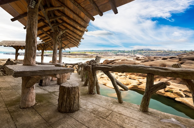 Wooden porch at the natural stone park view point on blue sky background