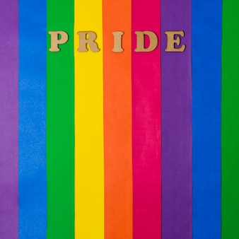 Wooden pride word and bright lgbt flag