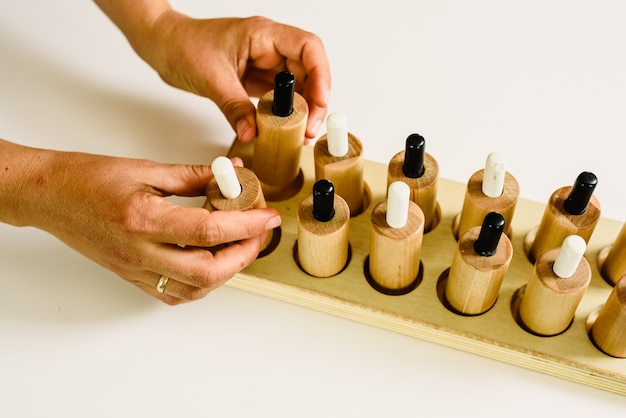Wooden push-buttons in a montessori classroom pulsed by the teacher