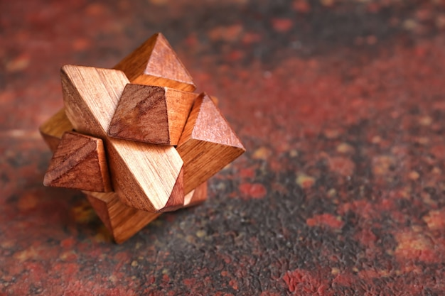 Wooden puzzle on color background