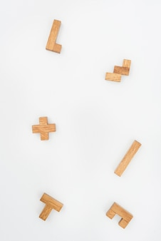 Wooden puzzle pieces as background