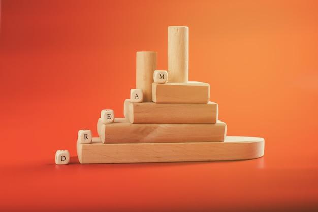 Wooden puzzle, teamwork concept. achieving a dream