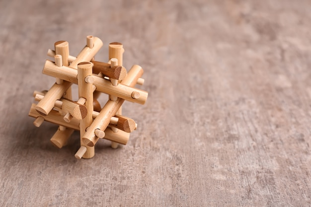 Wooden puzzle on textured