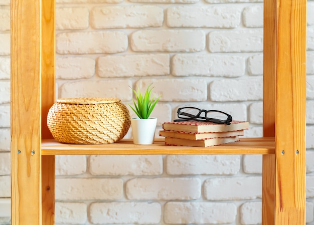 Wooden rack shelf with home decor stuff