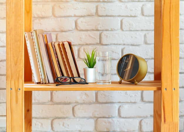 Wooden rack shelf with home decor stuff