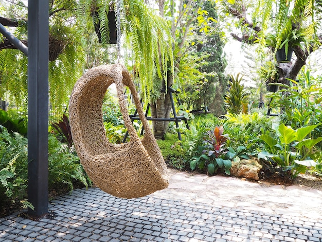 Wooden ratten seat like bird nest in the garden. natural outdoor terrace decoration.
