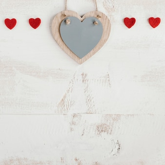 Wooden and red hearts with copy space