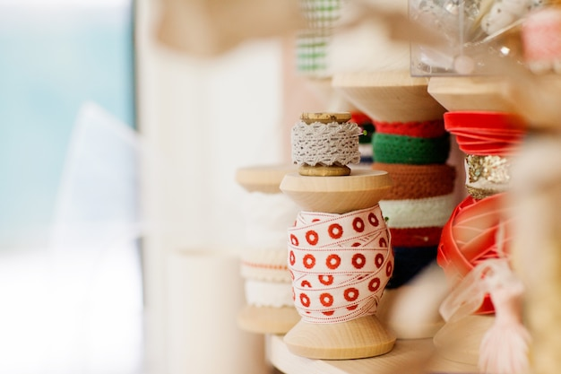 Wooden reel with lace ribbon for decoration