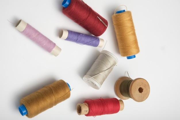 Wooden reels with thread on a solid background. tinting