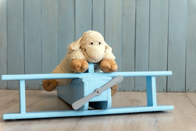 Wooden retro airplane model and sheep toy