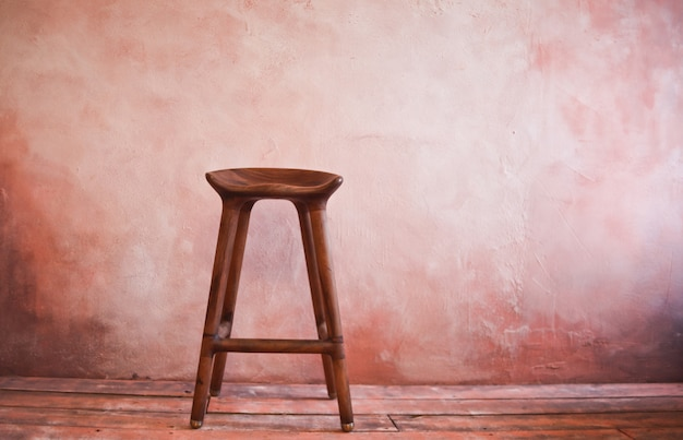 Wooden retro chair on the wall. copy space. vintage interior