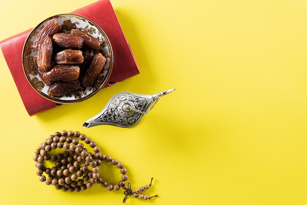 Wooden rosary and date fruit for ramadan wall