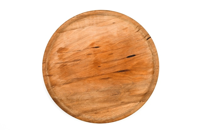 Wooden round tray on isolated white background . high quality photo