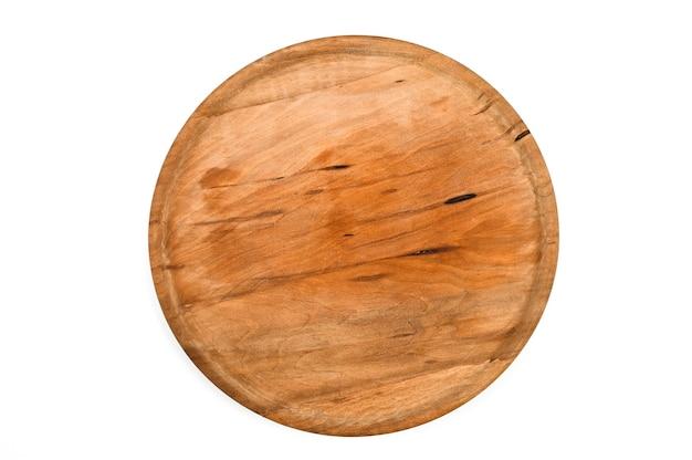 孤立した白い背景の上の木製の丸いトレイ。高品質の写真