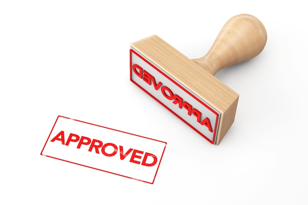 Wooden rubber stamp with approved sign on a white background