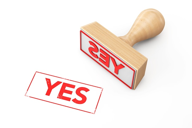 Wooden rubber stamp with yes sign on a white background