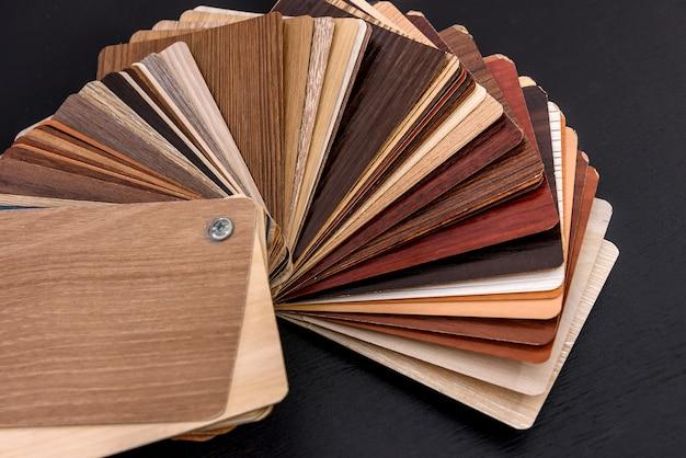 Wooden sampler on dark background close up