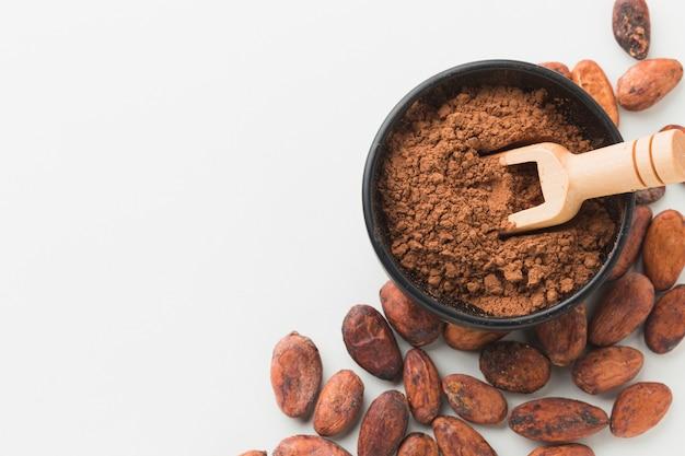 Wooden scoop in cocoa copy space