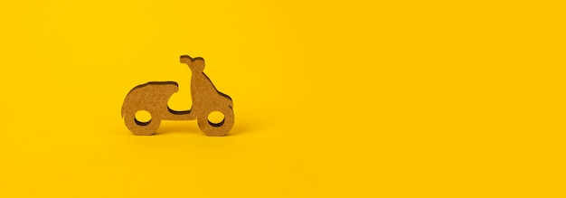 Wooden scooter on yellow background, symbol of delivery