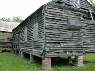 Wooden shack, brick