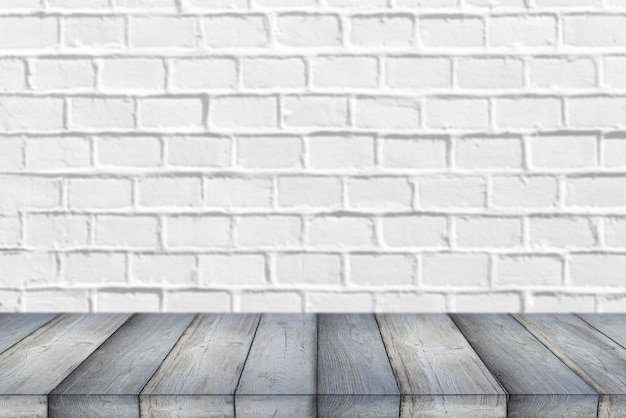 Wooden shelf or table in front of clean empty white brick wall background with space for text or ideas