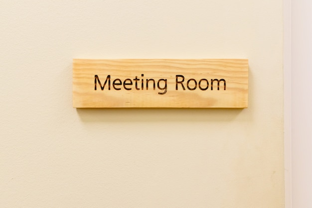 Wooden sign with the word meeting room