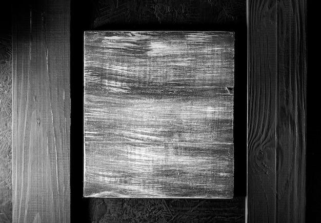 黒の背景テクスチャで木製看板