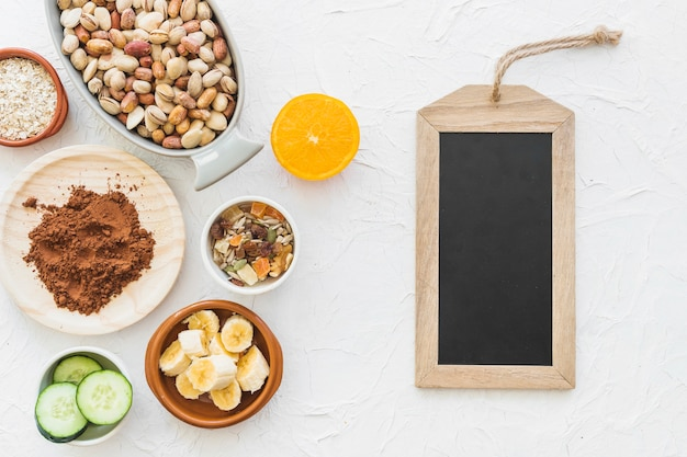 Wooden slate tag with ingredients on white backdrop