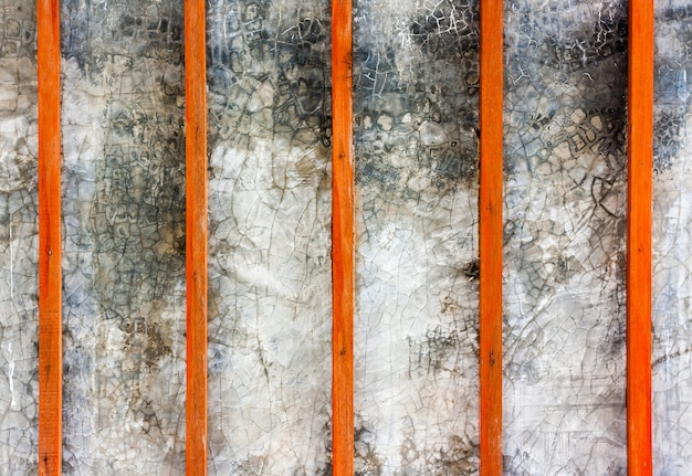 Wooden slats vertical plank line arranges pattern texture background with concrete texture.