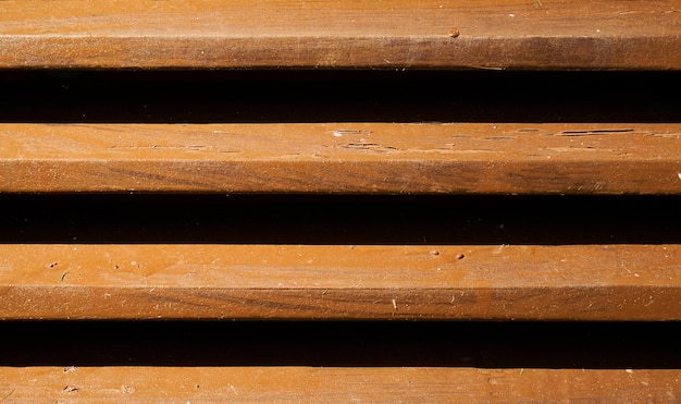 Wooden slats with black slits