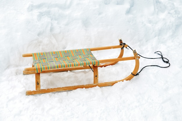 Wooden sled on snow