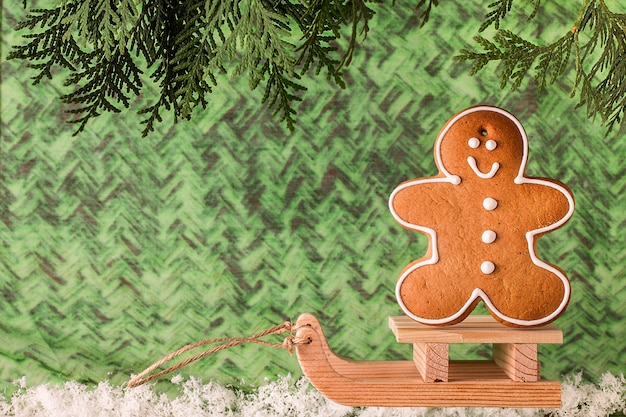 Wooden sled with  gingerbread man. christmas  concept
