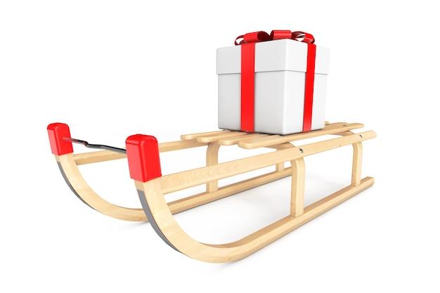 Деревянные санки с подарочной коробкой на белом фоне
