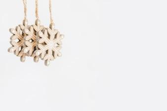 Wooden snowflake ornaments on white backdrop