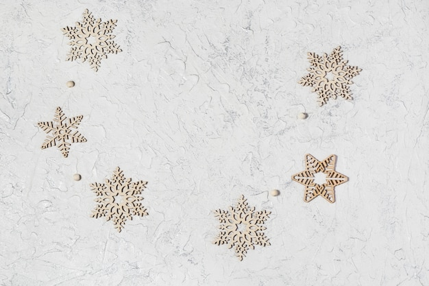 Wooden snowflakes on light background