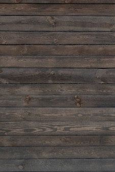 Wooden space. old dark wooden surface. wood planks. coarse texture. vertical frame