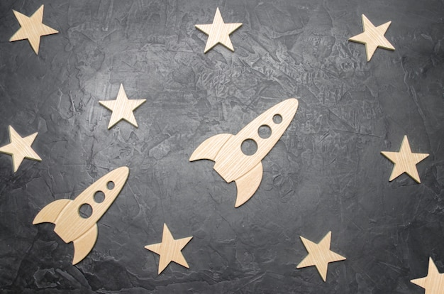 Wooden space rocket and stars. concept of space travels, the study of planets and stars.