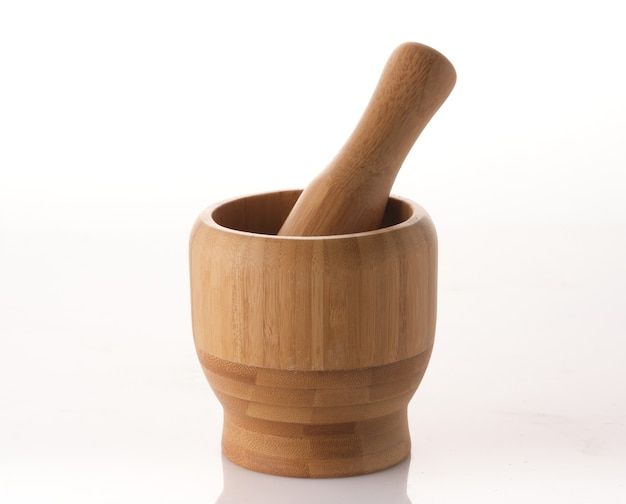 Wooden spice mortar with pestle on white background, isolated.
